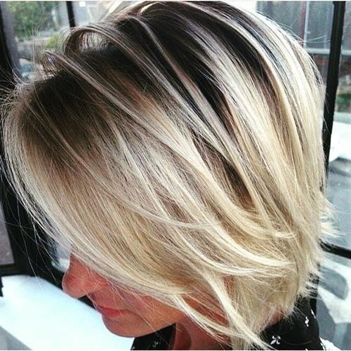 short shaggy blonde bob..love the color