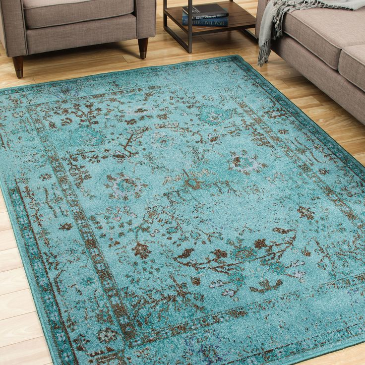 With the popular, modern washed style, this teal grey area rug is bright enough to add color to any room of your house. With a more muted color pattern, this rug is fashioned in an Eastern style that looks great with any style of furniture.