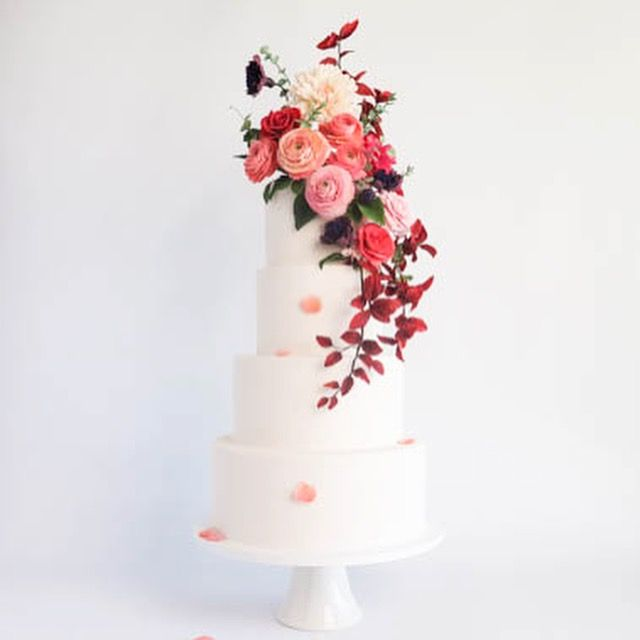 Stunning wedding cake by Cake Bijou in Australia, featuring beautiful sugar flowers, Ranunculus, dahlia, roses and plum branches. This element floral cake is at the top of its class when it comes to exclusive luxury cake design. And not only do the produce show stopping cakes, they also have a sugar art school! Amazing