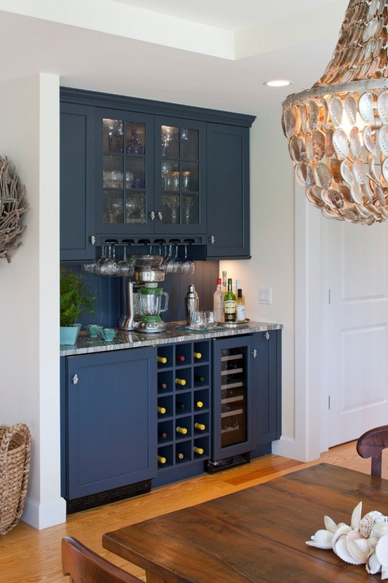 smaller version of this in cubby across from guest bath linen closet. Area for wine bottles, glasses above with a counter (including electric outlet) and cabinet below.