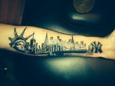 NYC Skyline Tattoo on my arm. Statue of Liberty. One World Trade Center. Empire State Building. Chrysler Building. Brooklyn Bridge. New York Yankees symbol. Love it!!  ©