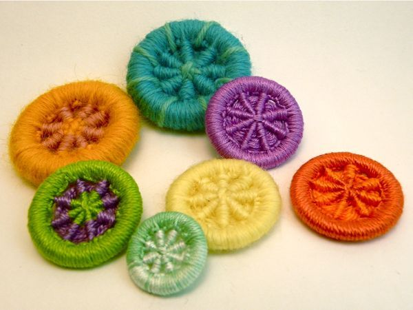 These yarn-based buttons look cute on a knitted or crocheted sweater, or make them to decorate a bag, hat, or scarf. They're a great way to use up scrap yarn, and easy to make once you've mastered the basics.
