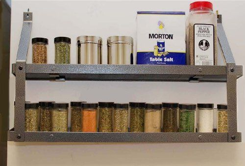 2-Tier Gourmet Spice Rack by Rogar by Rogar. $59.00. Manufactured in the USA. Small enough to fit in any sized kitchen. Gourmet spice rack is made of steel with a hammered Steel Finish. Easy access to everyday kitchen items. Properly displays your Spices and other kitchen ingredients. The cool, contemporary styling of this Wall Mount Spice Rack will flatter any kitchen! Never dig for spice bottles again when you've got this attractive rack mounted conveniently near th...