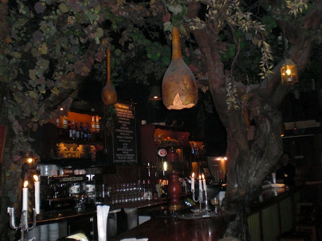 El Bosc de les Fades (Forest of Faries) bar in Barcelona, Spain.   You can choose to sit on a toadstool or cross the little bridge across the grotto while the ambience is further enhanced by the background noise of forestry sounds, distant storms, insects and wild animals.