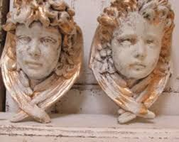 Cherub angels, boy with curly bangs and girl solemn & adorable.