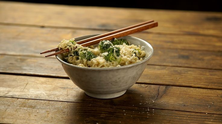 Recipe with video instructions: Magic happens when mac and cheese meets instant ramen. Ingredients: 1 package chicken-flavored instant ramen, 1 cup milk, 1 clove garlic, chopped, Pinch of nutmeg, Mushrooms, spinach or broccoli, ¼ cup Parmigiano-Reggiano