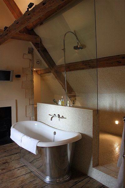 bathtub in front of walk-through shower