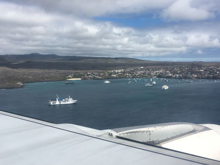 Flying into Puerto Baquerizo Moreno, San Cristobal Island. All journeys to the Galapagos begin with a flight from mainland Ecuador, almost 1,000km distant. I flew from Guayaquil on the Pacific coast to the island of San Cristobal. On the approach, I spotted the Yacht Isabela II in the harbour.