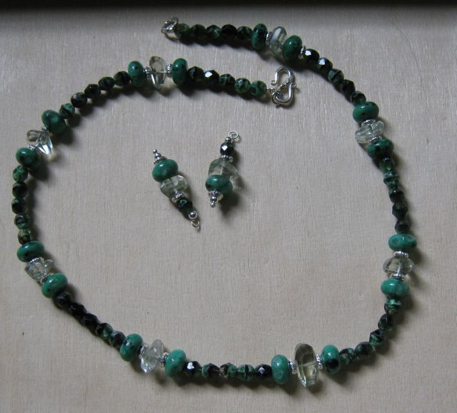 Necklace and earrings, green beads (various kinds) and crystals