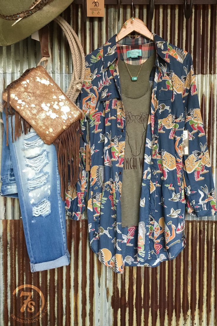- Rain dancer print duster/dress - Dusty navy blue background with colorful Indian print - Collared with with tortise shell snap button down - Double front pockets - Long sleeve with roll up button ta