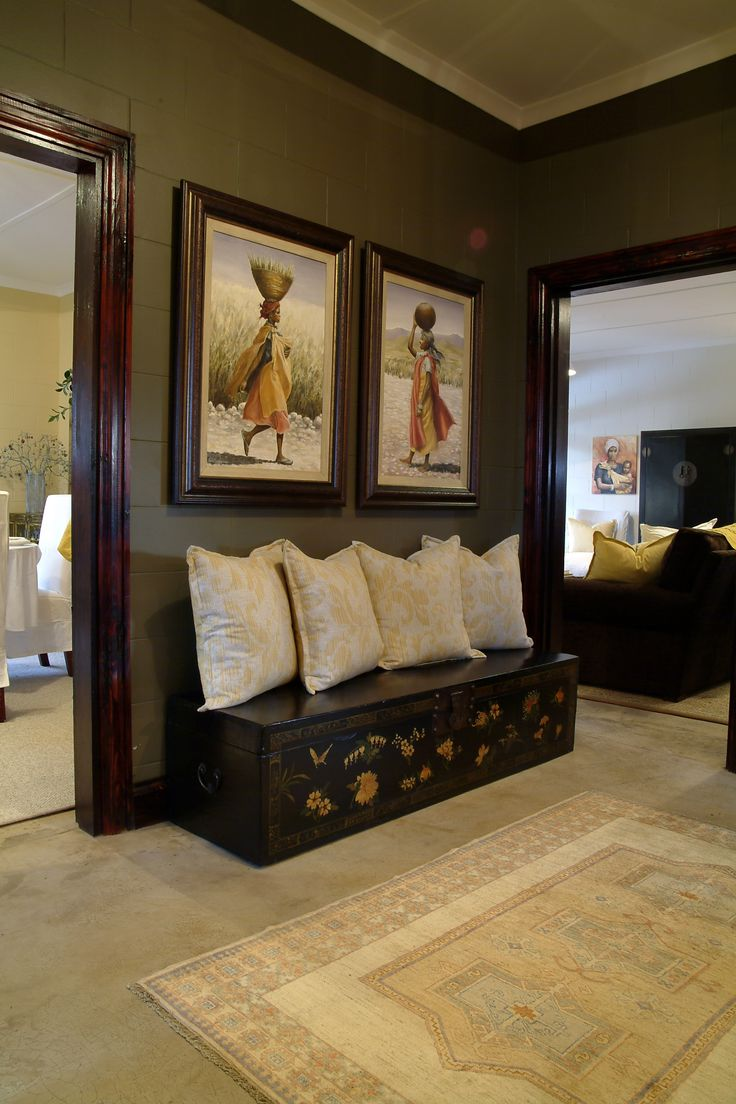 african inspiration chest lined with pillows as a mock bench - African Bedroom Decorating Ideas