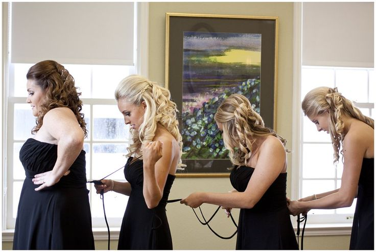 Elegant, fall wedding at Marie Selby Botanical Gardens in Sarasota, Florida. Bridesmaids helping each other get dressed. Bridal suite inside the Christy Payne Mansion. Black Bill Levkoff bridesmaids gowns. Funny bridesmaid photos. ©Degrees North Images #sarasotaweddingphotographer