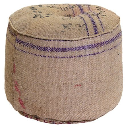 Take a break and rest your feet on this upcycled burlap ottoman, a charming addition to the living room or library.