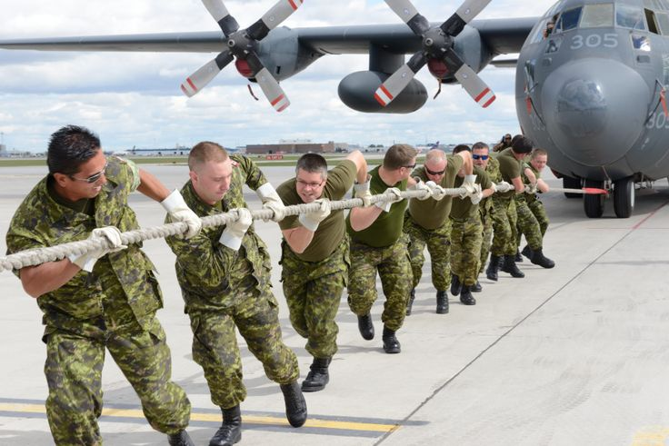 Soldiers from 38 CBG HQ give it their all pulling the C-130 at the annual Herc Pull. They finished second with a time under 30 secs.  Photo by MCpl Bern LeBlanc, Canadian Army Public Affairs, LFWA HQ  #StrongProudReady