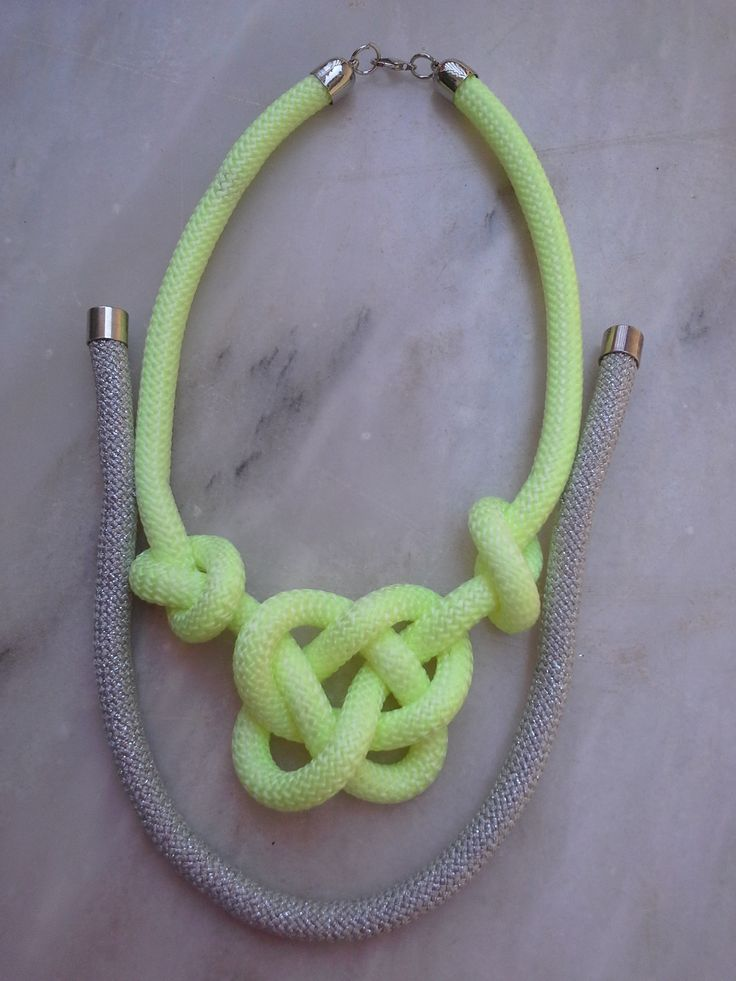 A combination of neon yellow and silver rope in a nautical knot