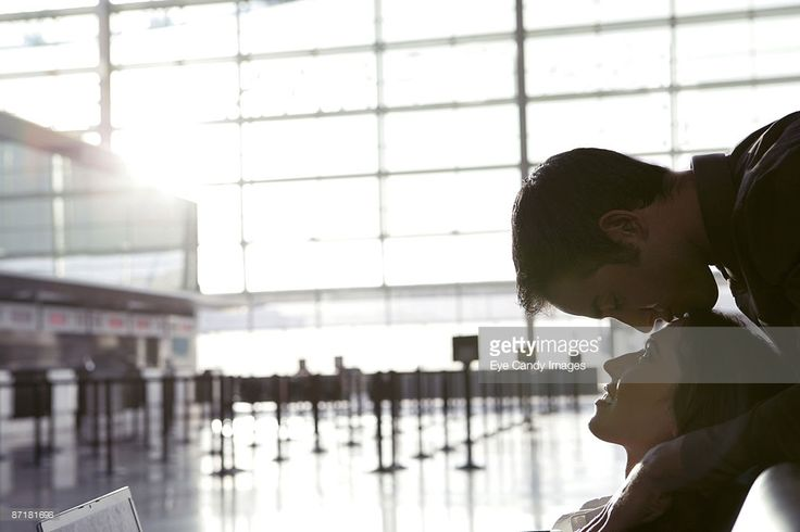 Stock Photo : Young affectionate couple in airport.