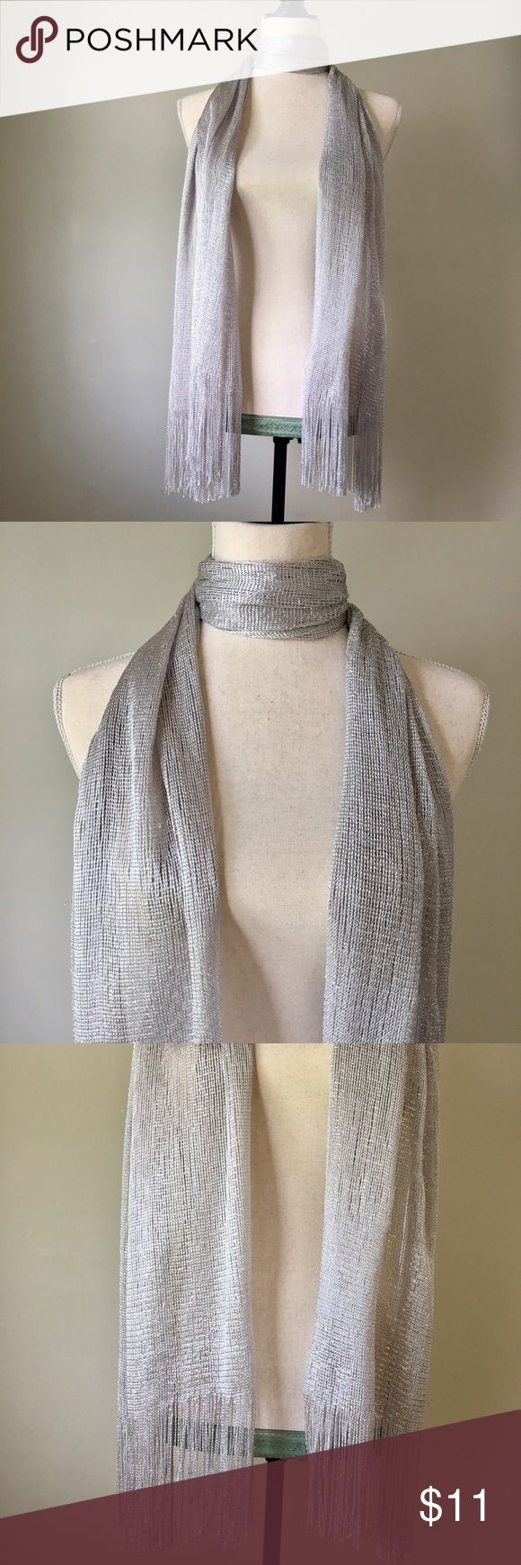 "Long Silver Scarf Never worn long silver and metallic threaded scarf that shimmers when the light catches.  Approximately 80"" long by 20"" wide. Super cute with a pair of skinny jeans and a simple white tank. Very retro looking🌼 Accessories Scarves & Wraps"