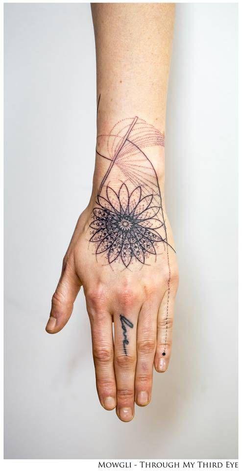 'Kundalini' - Graphic style mandala tattoo on the left hand. Tattoo artist: Mowgli lines X