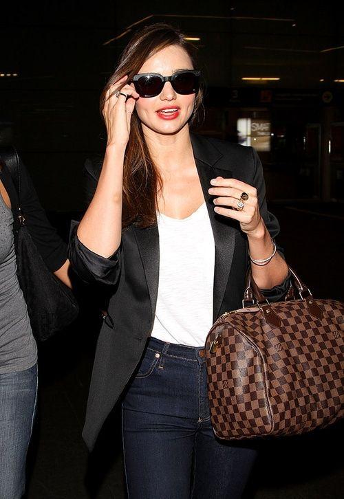 Miranda Kerr and her Louis Vuitton Damier Speedy! My fave purse ever.