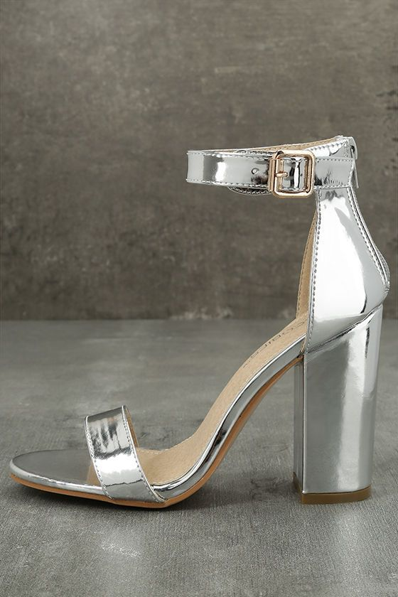 """Say hello to your new dancing shoes ... the Emalia Silver Patent Ankle Strap Heels! Patent vegan leather is molded to a classic single sole silhouette with toe strap, structured heel cup, and adjustable ankle strap with gold buckle. 3.5"""" heel zipper."""
