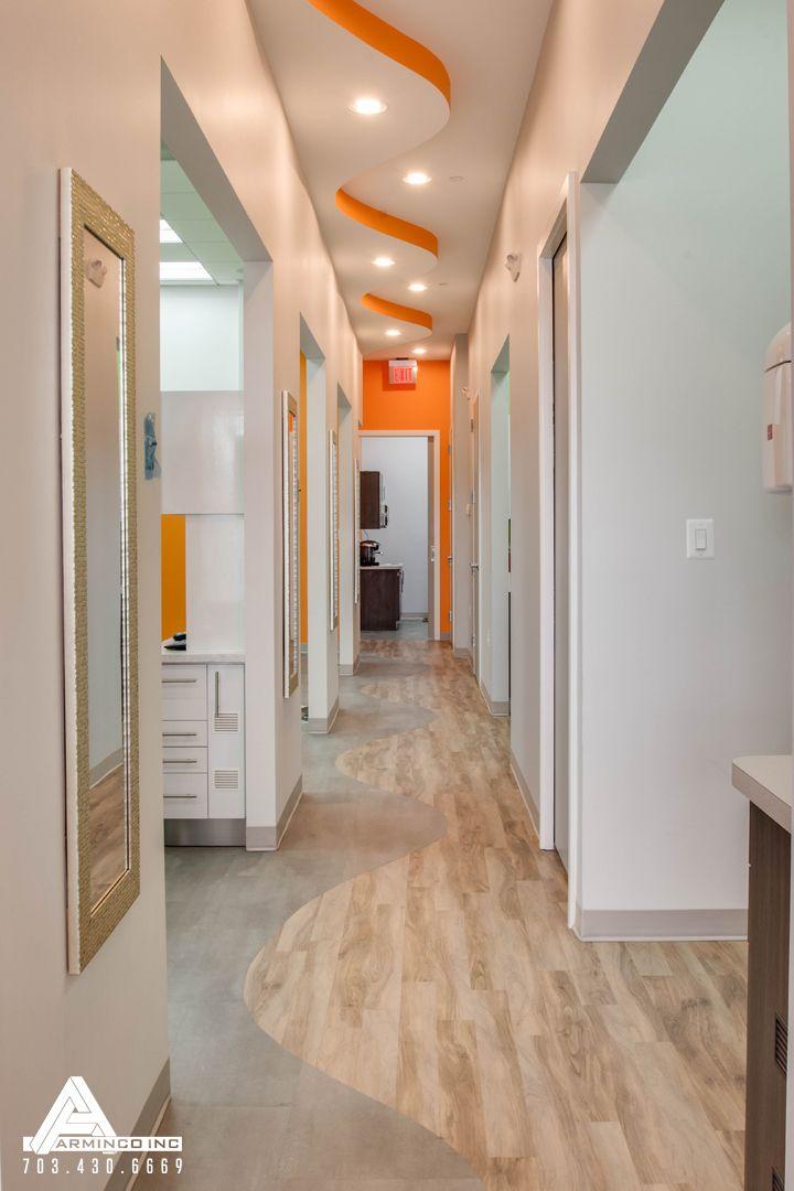 Undulating Orange Curved Ceiling. Dental Office Design by Arminco Inc.