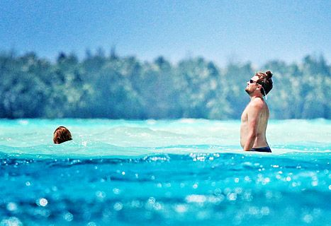 Leonardo DiCaprio Goes Shirtless, Rocks Man Bun With Toni Garrn - Us Weekly