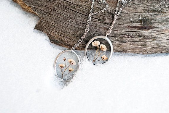 Handmade oval glass lockets with pressed flowers of gypsophila. It`s small and simple, but beautifull and unique necklaces. Dainty glass oval pendants