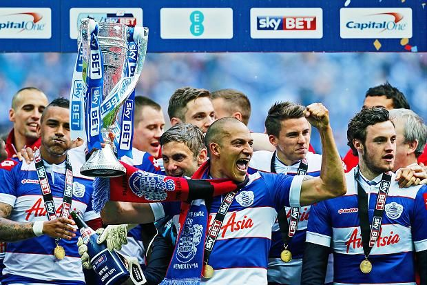 QPR's Bobby Zamora celebrates with the trophy and team mates after winning the Championship Play Off Final