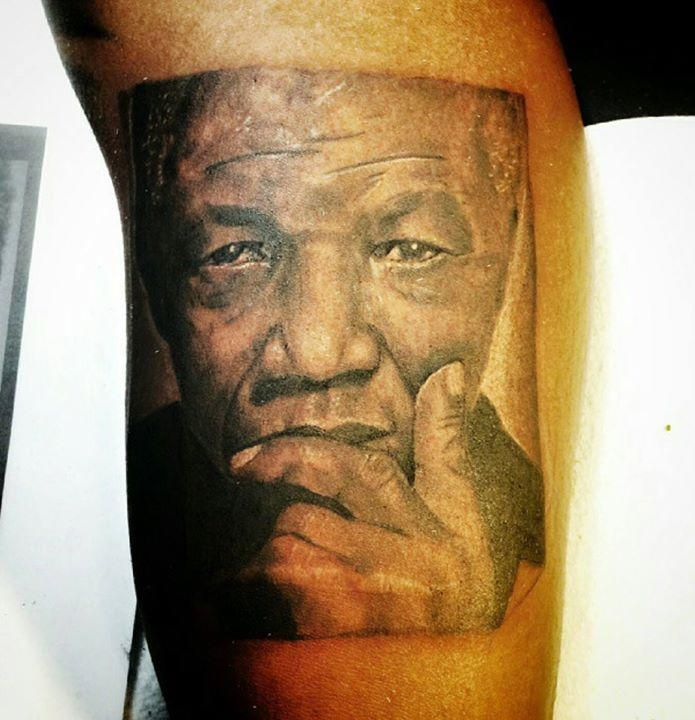 ... Nelson Mandela Photo Realism Tattoo Pictured above is a tattoo done by