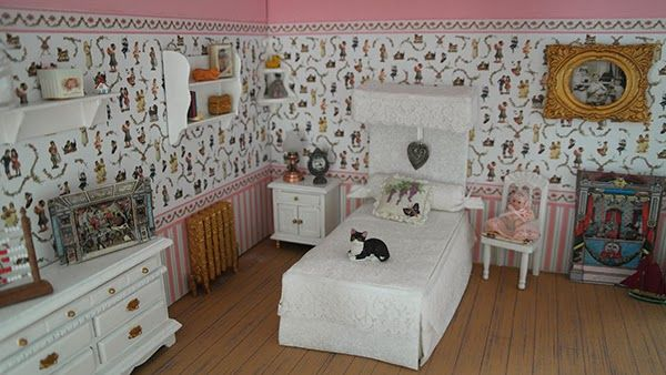 The girls bedroom of the dollhouse that I build in a display case