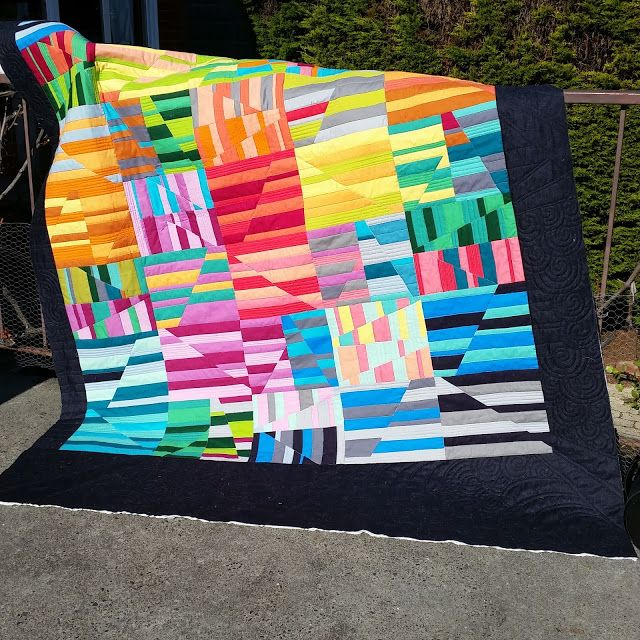Jess from The Elven Garden and her talented friends at the Tasmanian Modern Quilt Guild made this fantastic raffle quilt using Robert Kaufman Fabrics, #Aurifil thread and a pattern by Carolyn Friedlander llc.