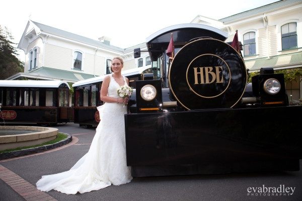 The lovely bride Sarah chose the Hawke's Bay Express as her luxurious wedding transport, this at the Mission Wine Estate. Photograph by Eva Bradley Photography HBExpress.co.nz