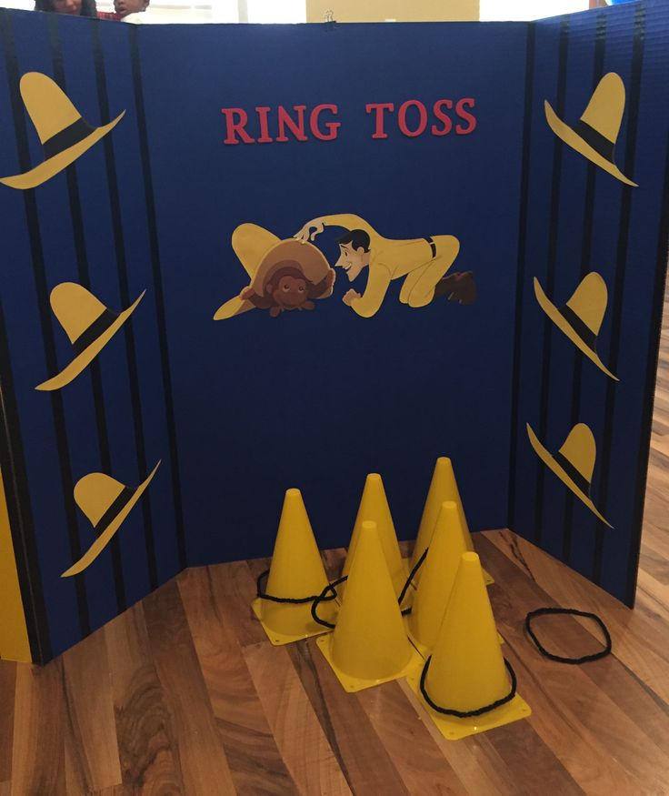 Ring toss game for Curious George 1st birthday party using a tri-fold posterboard.