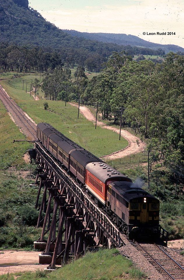 Goodwin Alco DL500B series 44 class unit, 4433 hauls the Up Tenterfield Mail over Bluff River Bridge on 14th January 1983. Photograph by Leon Rudd.
