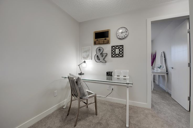 This hallway has a small niche that is perfect for a simple work space. It could also be used as a reading nook or crafting area and had plenty of wall space to hang artwork or wall organizers as seen here,
