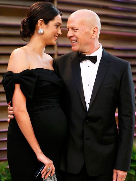 Bruce Willis only has eyes for expectant wife Emma Heming at the West Hollywood Vanity Fair post-Oscars party.