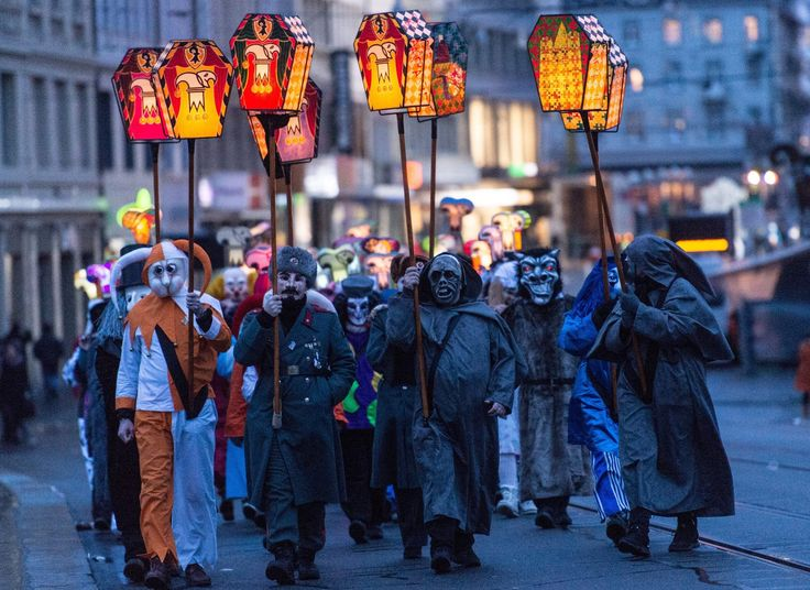 Basel, Switzerland - Revellers bearing lanterns parade through the streets. The traditional Morgestraich, which starts on the Monday after Ash Wednesday, marks the beginning of Basel's carnival. Photograph by Patrick Seeger