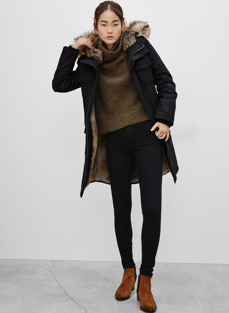 Stand out among other stylish civilians in a black parka and black slim jeans. Brown suede chelsea boots are a nice choice to complete the look.   Shop this look on Lookastic: https://lookastic.com/women/looks/black-parka-olive-cowl-neck-sweater-black-skinny-jeans/22947   — Olive Cowl-neck Sweater  — Black Parka  — Black Skinny Jeans  — Brown Suede Chelsea Boots