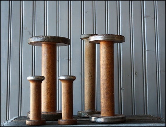 """antique wooden spools.  I LOVE THESE... they represent a time gone by of the textile industry that was so important to my family.... I miss the """"fine suiting"""" industry very much."""