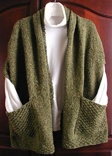 Ravelry: Reader's Wrap pattern by Lisa Carnahan.................Would be great for traveling.