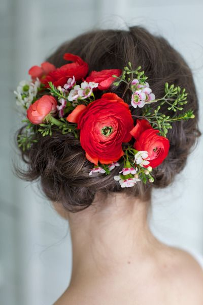 Fresh flower updo with ranunculus: http://www.stylemepretty.com/canada-weddings/2014/08/04/romantic-barn-wedding-inspiration-shoot/ | Photography: Valerie Busque Photography - http://www.valeriebusque.net/