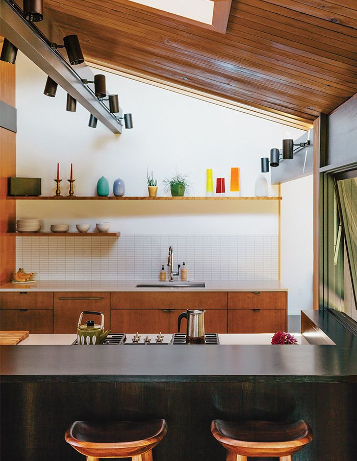 Midcentury Portland kitchen with Ann Sacks tile and barstools- should I do the same lighting to my exposed beams?