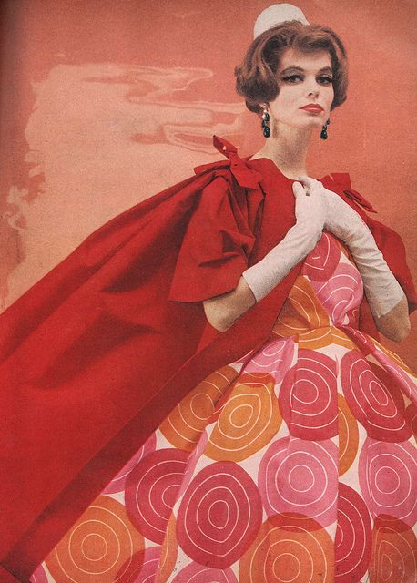April Harper's Bazaar 1959    Lacquer red silk crowded with beige and bright pink blossoms is cut with exquisite detail - from the loose oval sweep of the kimono sleeved jacket to the oval hem of the dress. By Leslie Morris, to order at Bergdorf Goodman.