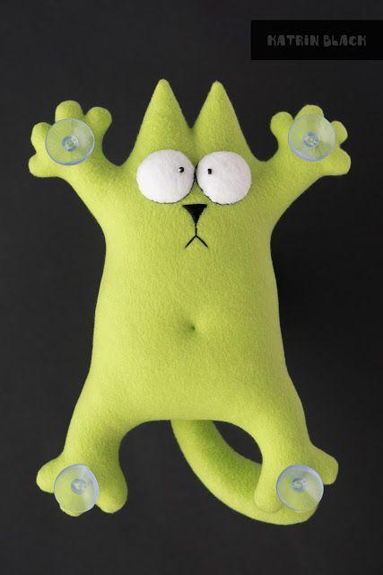 Кот Саймон - игрушка в машину на присосках.