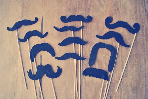 Set of 12 // Mustaches on Sticks // Soft Felt // Double-Layered // Photo Props // Photo Booth Props // Felt Photo Props. $40.00, via Etsy.