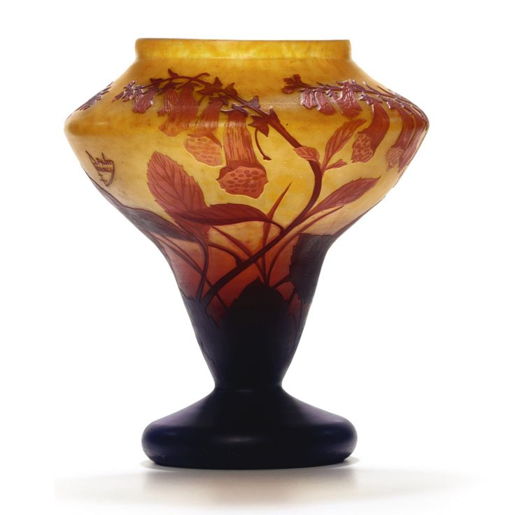 A DAUM CAMEO GLASS VASE CIRCA 1910 colourless glass with yellow powders, overlaid in orange and brown and etched with flowers and leaves cameo mark Daum Nancy with Lorraine cross height 26 cm