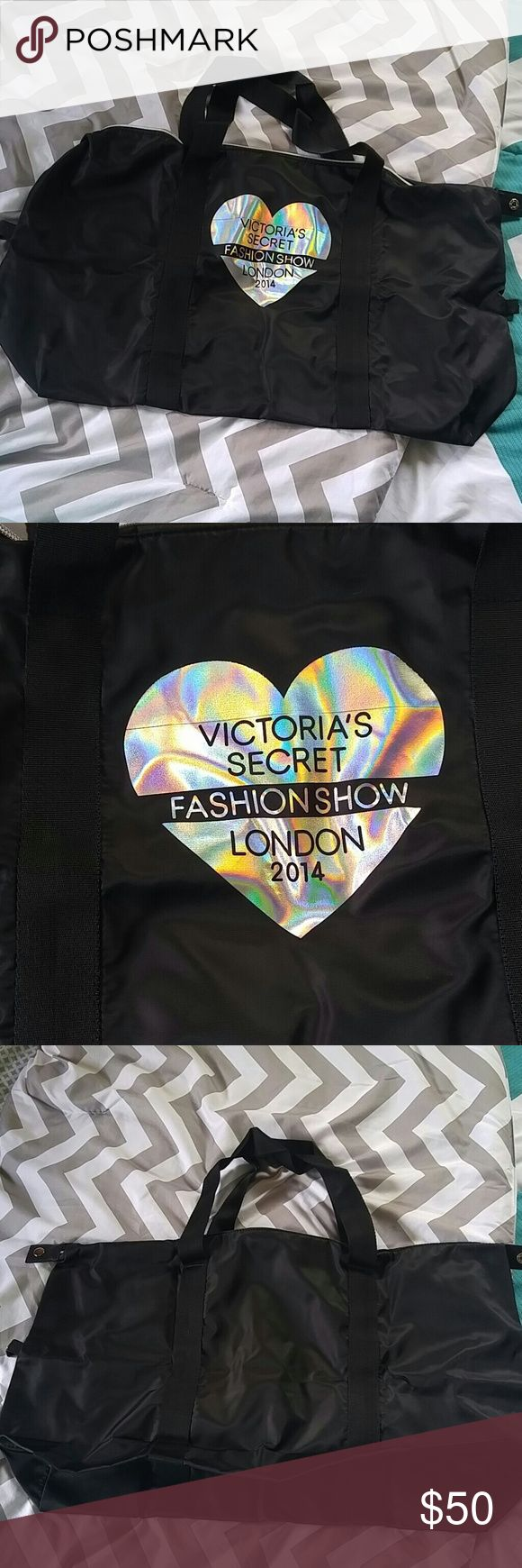 Black Victoria's Secret Fashion Show London 2014 💟💋Black satin Victoria's Secret Fashion Show London 2014 bag has a bag inside of a clutch bag the zipper closure has wings hologram heart that says her choice Secret Fashion Show London 2014. The bag is a large duffel bag that zips all so you could snap the small bag you carry the large bag in on the outside. This is never been used has been left in the plastic Store app. NWOT firm on price no sales no trades watch for Flash sales or add to…