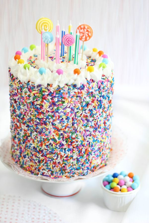 This cake has a secret: It's really a Rice Krispy Sprinkles Cake. Yay for such a super fun birthday cake alternative! | Find the recipe at Sprinkle Bakes