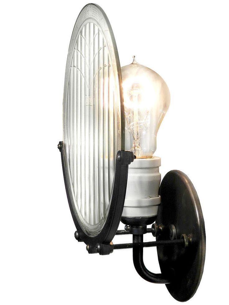 1915 Automobile Headlight Lens Sconce | From a unique collection of antique and modern wall lights and sconces at https://www.1stdibs.com/furniture/lighting/sconces-wall-lights/