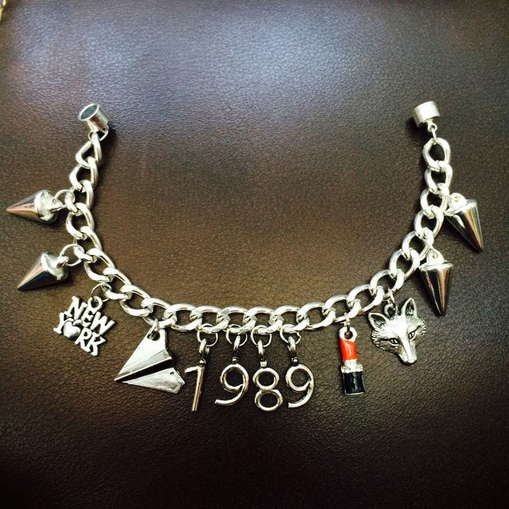 Taylor Swift 1989 Inspired Charm Bracelets by flyjewelry209 on Etsy https://www.etsy.com/listing/231826993/taylor-swift-1989-inspired-charm